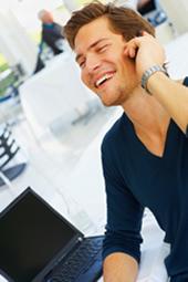 confident man trading on phone