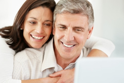 couple trying to understand bids at laptop