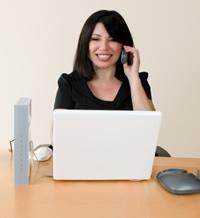 women trading on laptop